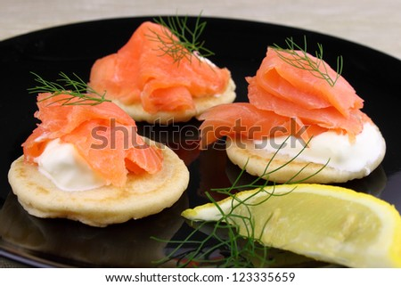 Blini pancakes served with Creme Fraiche, Smoked Salmon and garnished with Dill. Stock photo ©
