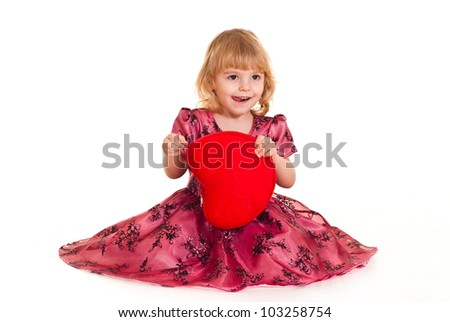 Bliss Caucasian young girl sitting with a pillow on a white background