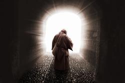 blissed Friar with faith on god walking toward the light