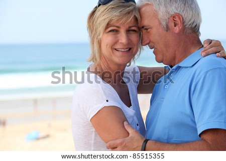 blissful middle-aged couple on holidays