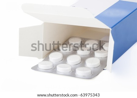 blister pack of pain medication in box, isolated on white background.