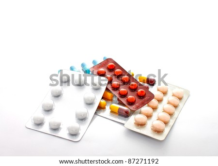 blister packs of pills on white background