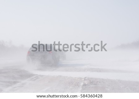 Blizzard in the road and bad visibility. #584360428