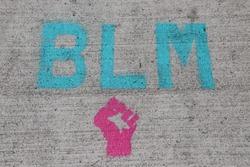 BLM Black Lives Matter Stamp on Sidewalk
