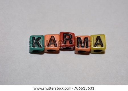 Block letter bead word spelled out in multicolored alphabet karma. #786615631