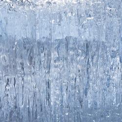Block of blue smooth melting ice, close-up