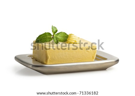 Block of butter on a butter dish. Isolated on white incl. Clipping Path