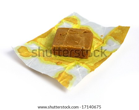 Block of dehydrated flavor with their package on white background
