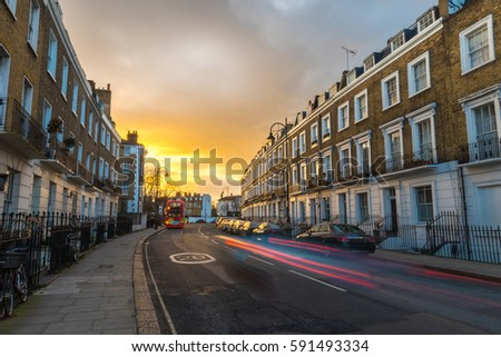 Block of flats at sunset and the light of the cars marking lines during the long exposure at rush hour