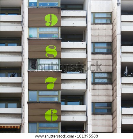 block of flats with numbers for the floors