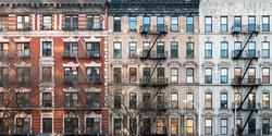 Block of historic apartment buildings on Eldridge street in the Lower East Side neighborhood of Manhattan in New York City NYC