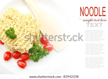 Block of Raw Instant Noodle on the plate with Tomato