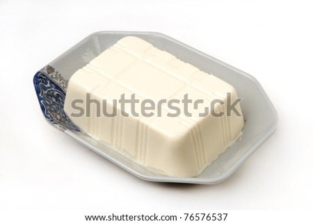 Block of tofu isolated on white background