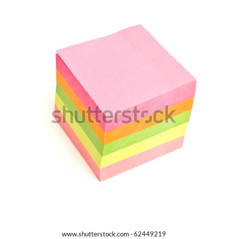 Block of vibrant multicoloured Post it Notes isolated on white.