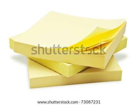Block of yellow Post it Notes isolated on white.