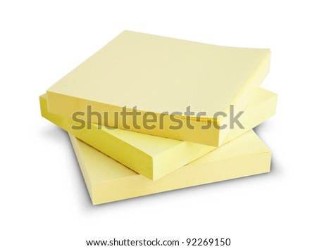 Block of yellow Post it Notes isolated on white