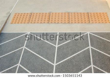 Block tactile paving for blind handicap. Tactile paving for blind handicap on tiles pathway, walkway for blindness people. #1503651143
