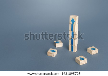 Block tower with arrows. Growth, development progress concept. Achieve success. Career promotion. Step by step. improving skills. Goal achievement. Progress and movement forward. Self improvement
