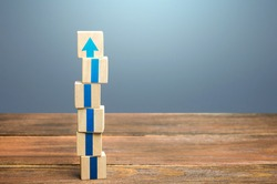 Block tower with blue arrows. Growth, development progress. Road map agreement concept. Career promotion step by step. Education, learning. Reaching a new level. Improving skills. Raising the standard