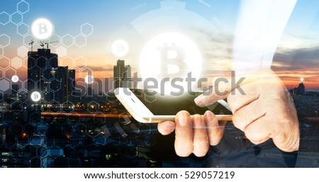 Blockchain , cryptocurrencies , bitcoin concept. Block chain and network connect icons. Business woman point finger to mobile phone screen with sunset city background. #529057219