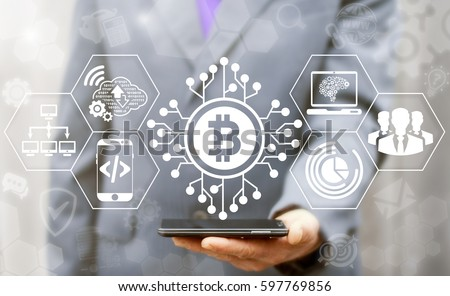 Blockchain finance web money business concept. Man offer smartphone with bitcoin microcircuit icon on virtual financial screen. Internet cryptocurrency block chain production and generation technology