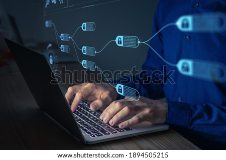 Blockchain financial technology to secure cryptocurrencies as bitcoin for online payments and money transaction. Fintech concept with encrypted ledger blocks chained. Person working on computer
