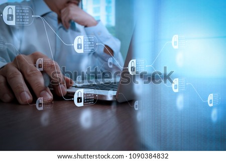 Blockchain technology concept with diagram of chain and encrypted blocks. close up of business man hand working on laptop computer with social media diagram on wooden desk #1090384832