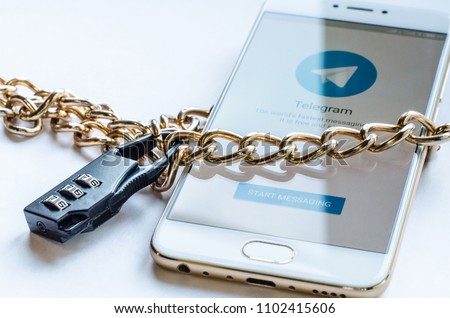 Blocked mesenger telegrams in Russia. The smartphone is chained and locked, as a symbol of private access to software. #1102415606