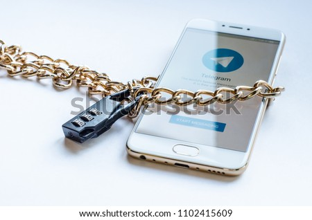 Blocked mesenger telegrams in Russia. The smartphone is chained and locked, as a symbol of private access to software. #1102415609