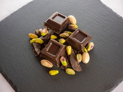 Blocks of chocolate with pistachios, unconventional flavors, ingredients for haute patisserie and dessert production
