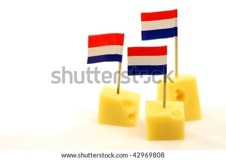 blocks of Dutch cheese with Dutch flag toothpicks on a white background #42969808