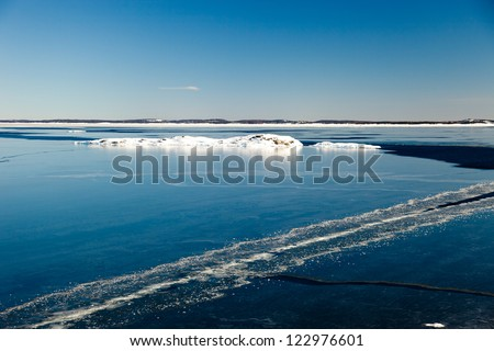 Blocks of ice on the coast of the frozen sea. - stock photo