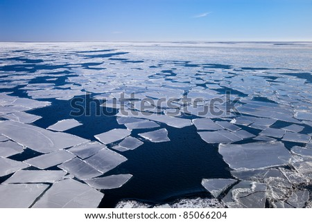 Blocks of ice on the coast of the frozen sea.