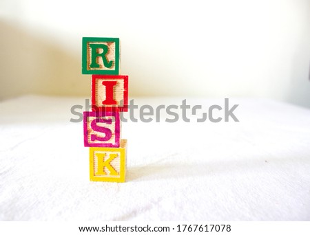 Blocks representing Risk from taking personal loan, home loan, education loan, bank loans, secured and unsecured loans, financial crisis, investment,