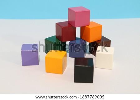Blocks. Selective focus block. Colorful wooden building blocks. Wooden block stairs. Colorful stack of wood cube building blocks. Multi-colored wooden blocks. Cube. Copy space. Colorful wooden cube.