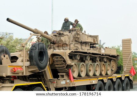 BLOEMFONTEIN, SOUTH AFRICA - February 2014: The Armed Forces parade the streets of Bloemfontein on February 21st, 2014 to commemorate World Armed Forces Day. Olifant main battle tank drive by