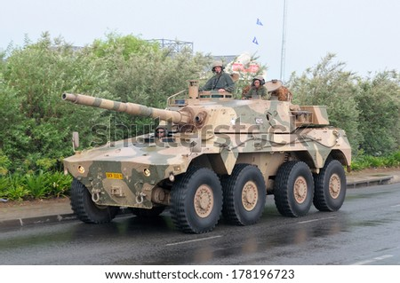 BLOEMFONTEIN, SOUTH AFRICA - February 2014: The Armed Forces parade the streets of Bloemfontein on February 21st, 2014 to commemorate World Armed Forces Day. Rooikat fighting vehicle drive by