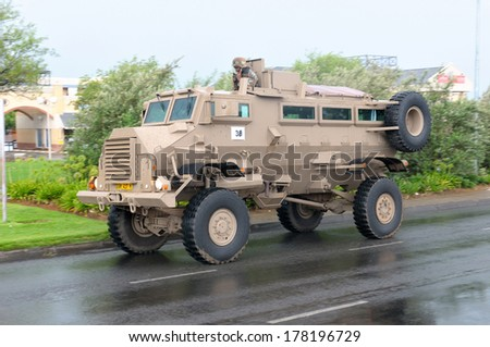 BLOEMFONTEIN, SOUTH AFRICA - February 2014: The Armed Forces parade the streets of Bloemfontein on February 21st, 2014 to commemorate World Armed Forces Day. Casspir MK3 Personnel Carrier drive by