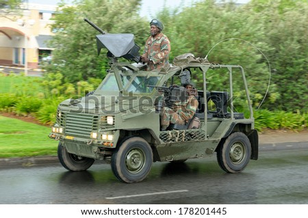 BLOEMFONTEIN, SOUTH AFRICA - February 2014: The Armed Forces parade the streets of Bloemfontein on February 21st, 2014 to commemorate World Armed Forces Day. Wasp reconnaissance vehicle drive by