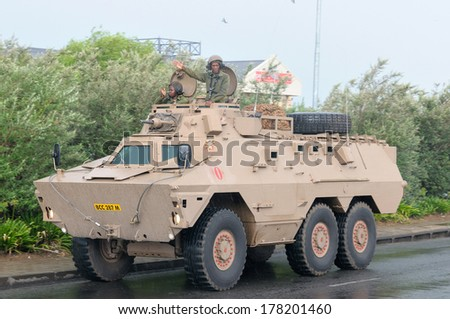 BLOEMFONTEIN, SOUTH AFRICA - February 2014: The Armed Forces parade the streets of Bloemfontein on February 21st, 2014 to commemorate World Armed Forces Day. Ratel infantry fighting vehicle drive by