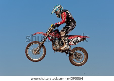 BLOEMFONTEIN, SOUTH AFRICA - JULY 19: Unidentified motocross rider jumps through the air during a national motocross racing event, on Jul 19, 2009 in Bloemfontein, South Africa.