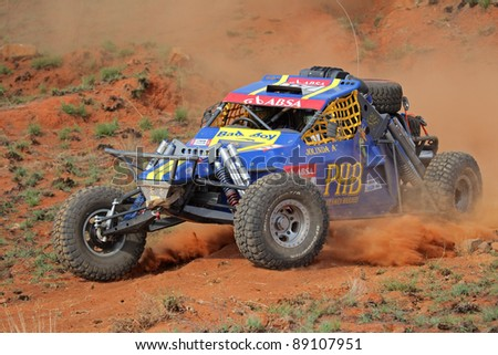 BLOEMFONTEIN, SOUTH AFRICA - OCTOBER 15: Marius and Jolinda Fourie in their BAT in action during a South African off road championship event in Bloemfontein, South Africa on October 15, 2011