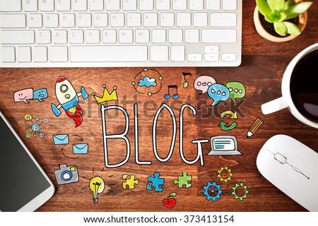 Blog concept with workstation on a wooden desk  #373413154