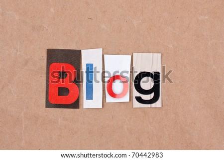 Blog, letters sorted on paper background