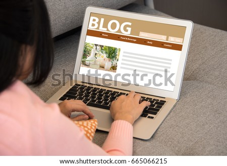Blog Social Media Information connect Concept. A woman uses a laptop to work at home, she writes a blog. #665066215