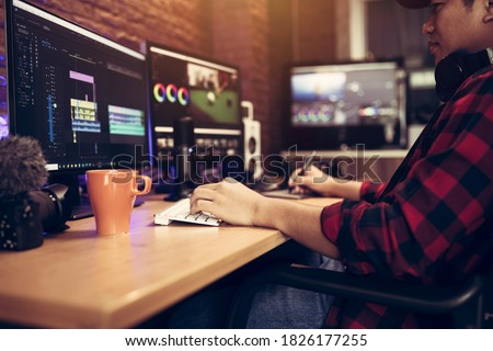 Blogger or vlogger working editing video footage job of the content creator Foto stock ©