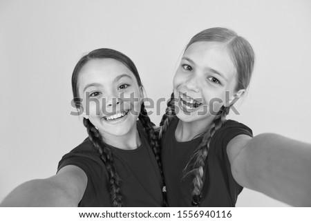 Blogging modern trend. Personal blog. Capturing moments. Child girls taking photo. Children kids happy faces. Video call concept. Blog online. Girls taking photo. Selfie for social networks or blog.