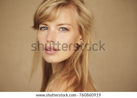 Blond and blue eyed beauty looking at camera Stock photo ©