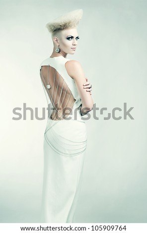 blond attractive woman in dress with creative hairstyle