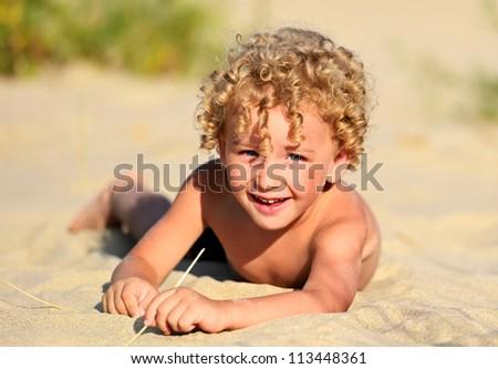 blond boy on a seashore